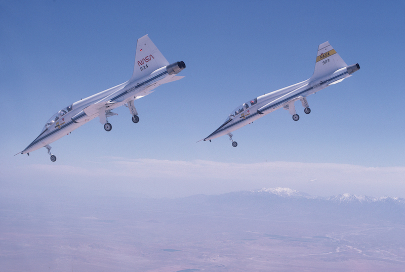 A pair of T-38s dive toward a runway at Edwards Air Force Base in Calif., on a steep approach like the one the shuttle uses on approach. Photo courtesy of Story Musgrave (Photo via NASA)