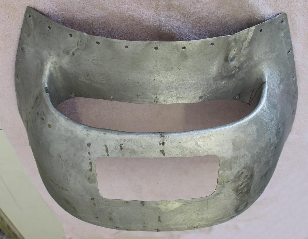 The banged-up original chin scoop. (photo via Tom Reilly)