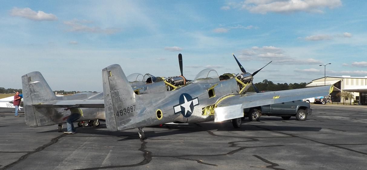 The XP-82 sitting out in the sunshine during her move to the new hangar. (photo via Tom Reilly)