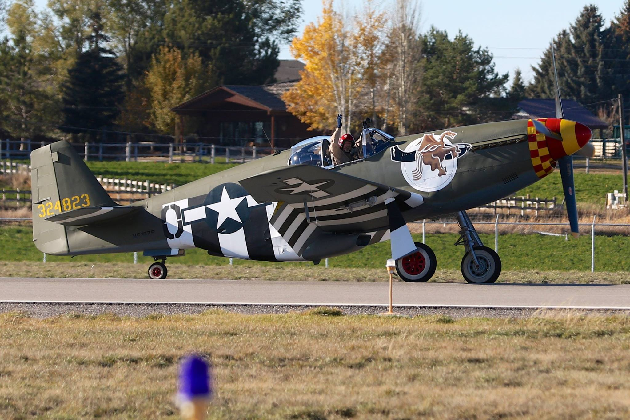 "John Muszala pumps his fists in jubilation after the first flight of his latest restoration, P-51B ""Berlin Express"". (photo via John Muszalla II)"