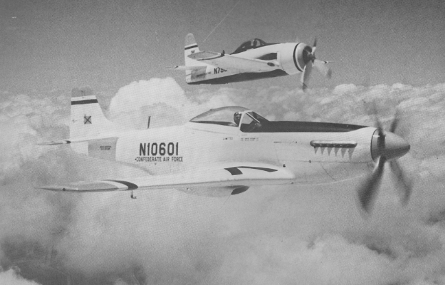 The  Mustang and the Bearcat in 1961 flying over the skies of Rebel Field ( Photo provided by Commemorative Air Force)