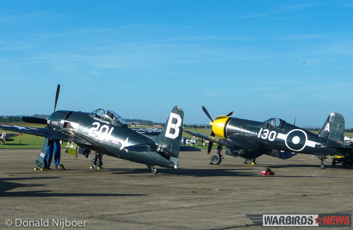 The Fighter Collection's Grumman F8F Bearcat sits beside their FG-1D Corsair on the tarmac at Duxford during the Meet the Fighters air show. The Bearcat opened the show paired up with a Hawker Fury. (photo by Donald Nijboer)