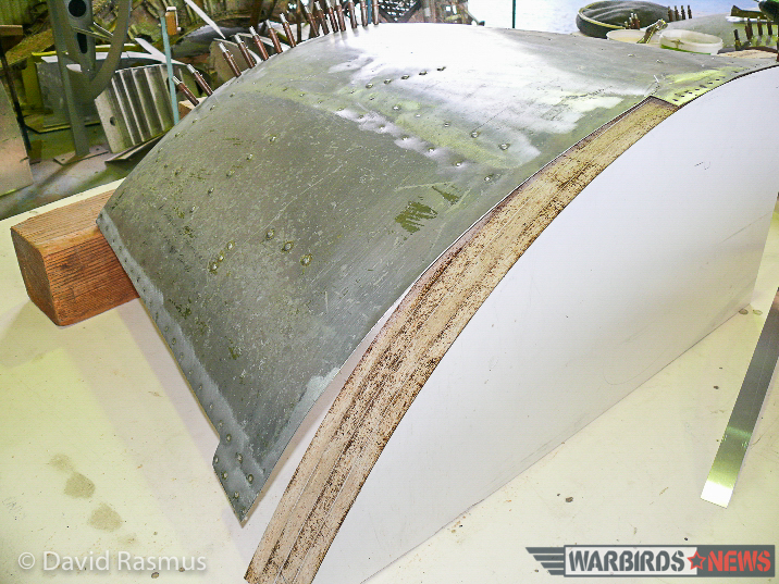 The skin from the cockpit roof showing where part of the panel had been cut away when the fuselage was hacked apart. (photo via David Rasmus)