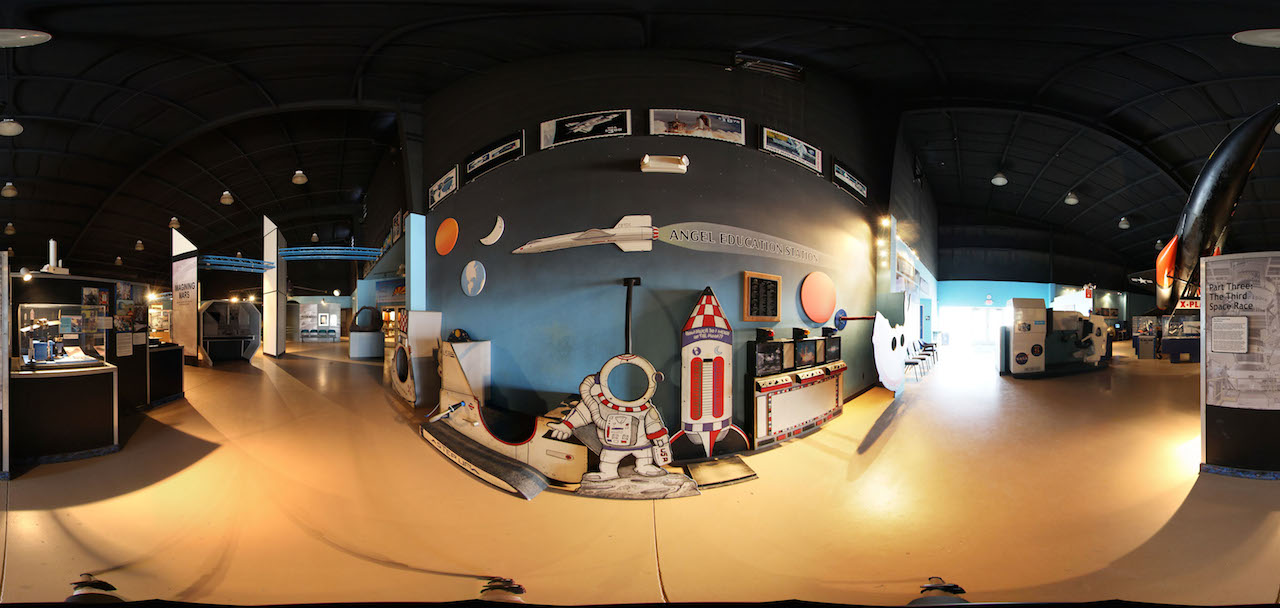 Lunar-landing and Genimi-docking Simulators surround the Angel Kids Gallery, the Moon Race and other exhibits in the Pima Air & Space Museum Space Gallery (panoramic photo by John Saunders)
