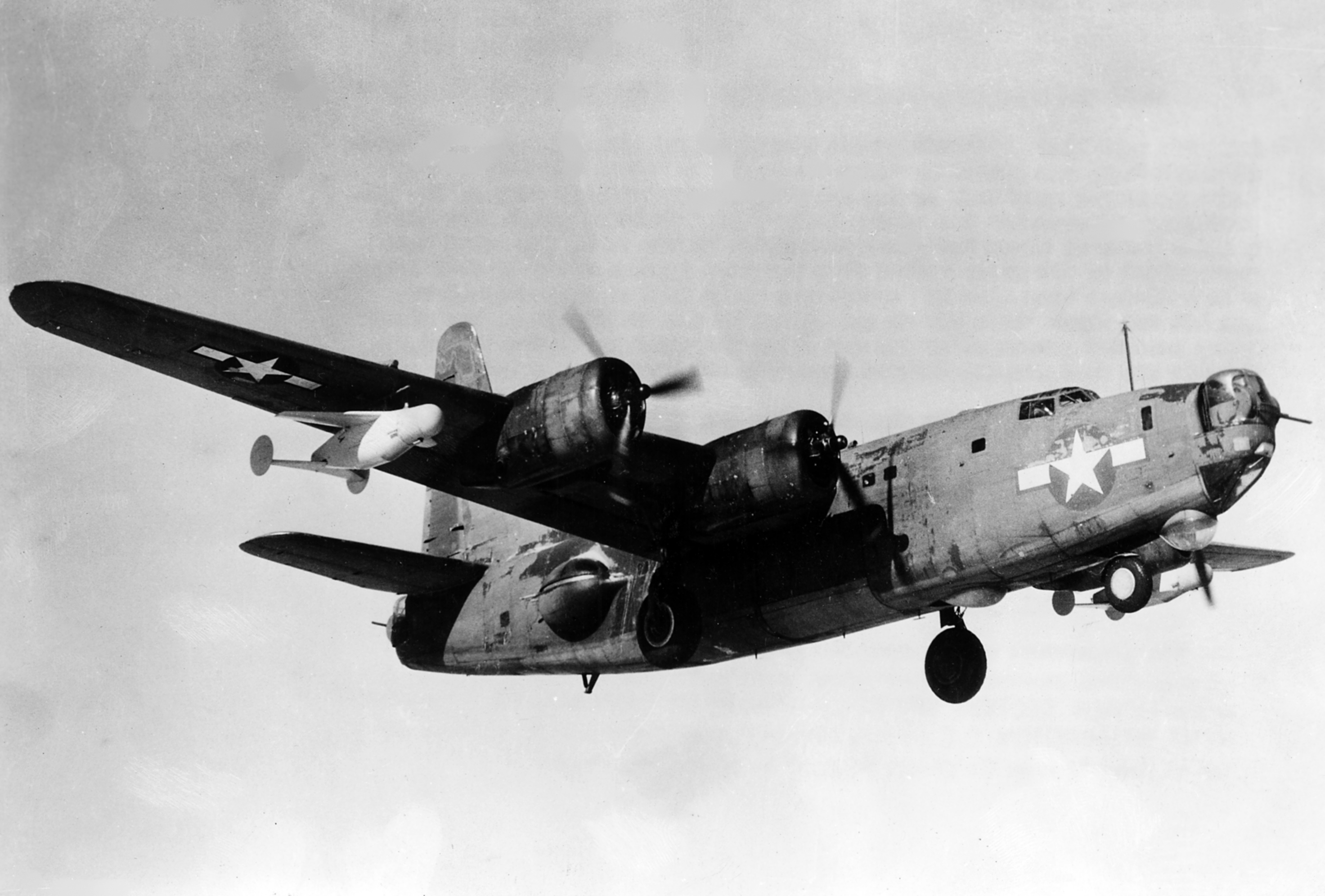A U.S. Navy Consolidated PB4Y-2 Privateer taking off with two ASM-N-2 Bat glide bombs attached. ( Source U.S. Navy Naval Aviation News February 1946 via Wikpedia)
