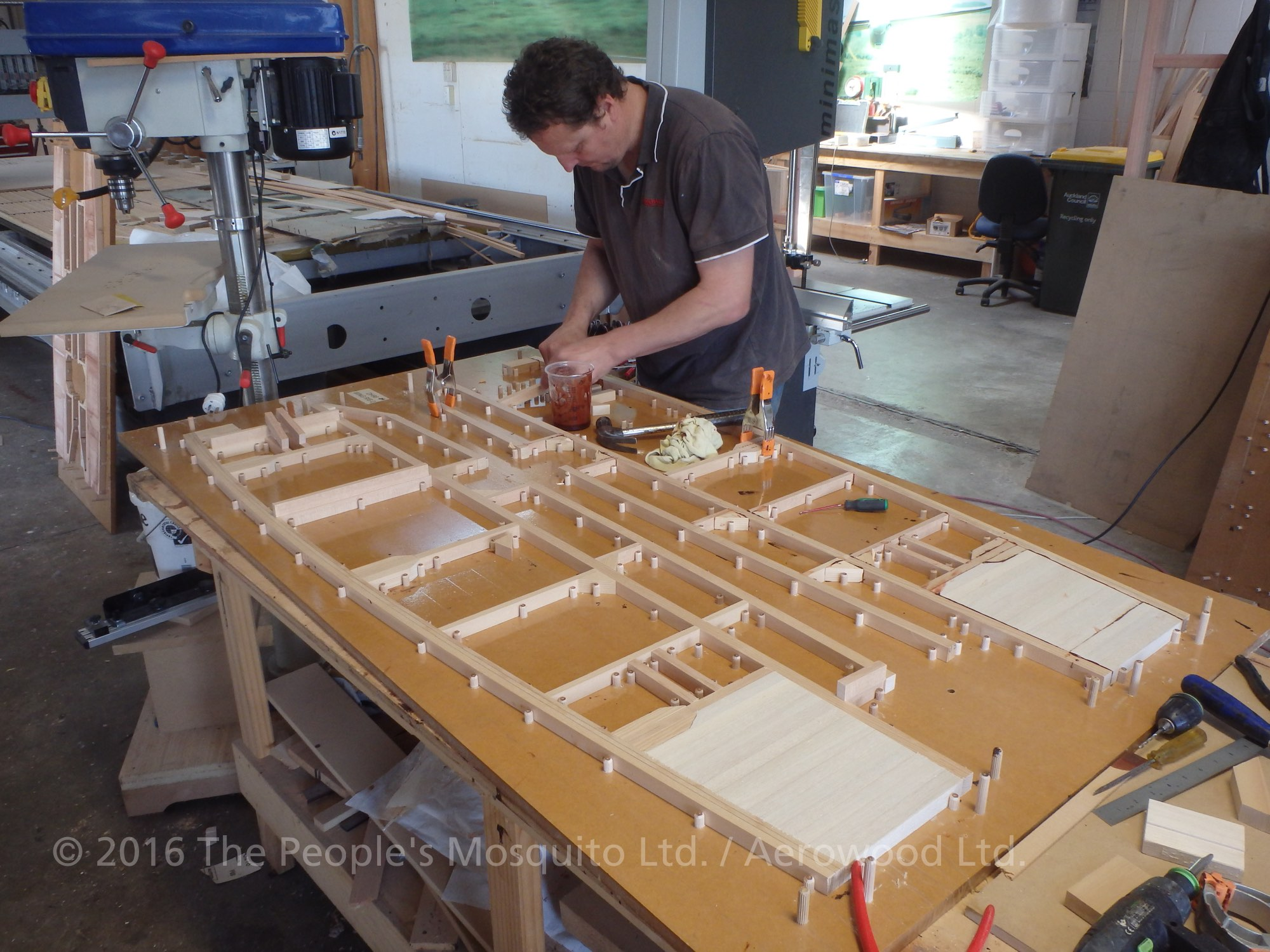 Assembling some of the wing ribs on one of the many different jigs. (photo via The People's Mosquito)
