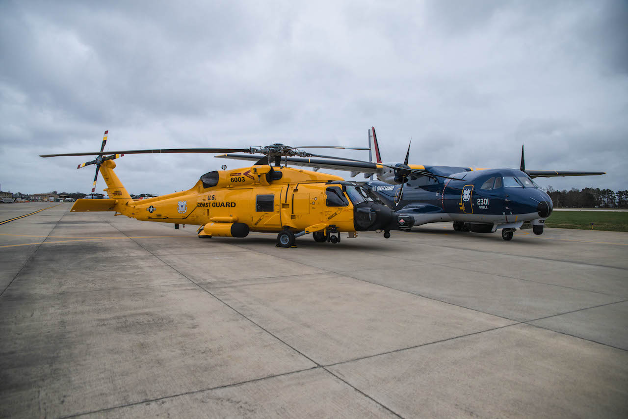PPG military topcoats and primers have been used to paint rotary- and fixed-wing aircraft commemorating U.S. Coast Guard aviation's centennial in 2016. Six MH-60 JAYHAWK™ helicopters have been repainted in 1950s-era yellow, and a dark blue and silver metallic livery flown from 1934 to 1943 has been recreated on two HC-144 Ocean Sentry aircraft. (Credit U.S. Coast Guard)