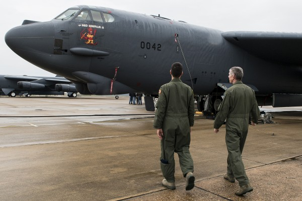 U.S. Air Force Col. Paul Tibbets IV (left) gets a closer look at the nose art on a 93rd Bomb Squadron B-52H Stratofortress, which resembles the nose art flown on the side of a B-17 bomber his grandfather piloted during World War II, at Barksdale Air Force Base, La., Nov 15, 2013. Brig. Gen. Paul Tibbets Jr., was best known for his atomic mission in the B-29 during World War II. (U.S. Air Force photo by Master Sgt. Greg Steele/Released)