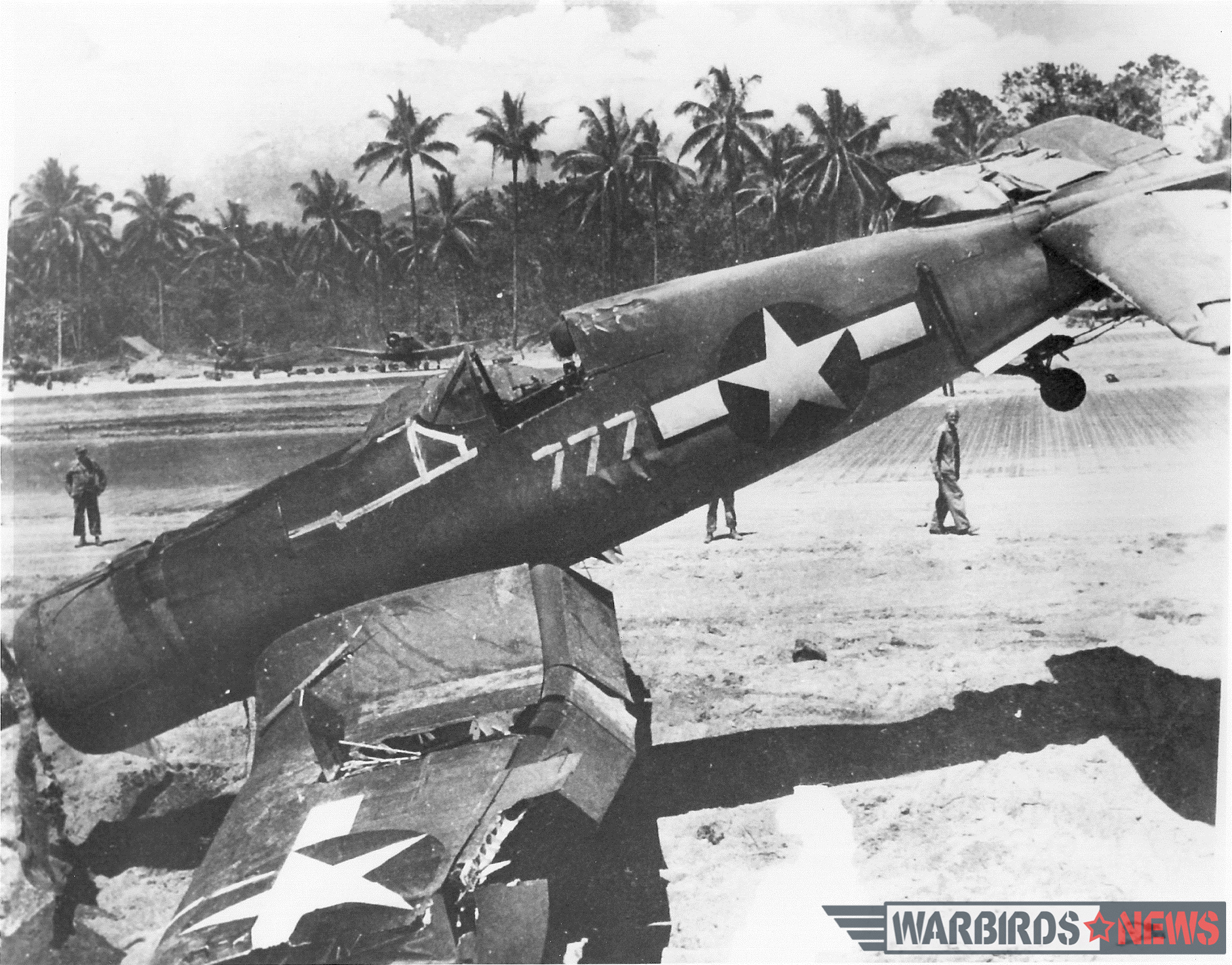 "Even when conditions were ideal, putting the high-performance Corsair down on a narrow runway of pierced steel planking could lead to trouble. If a pilot strayed off the edge of the paved runway and hooked a wheel in the soft shoulder, the result was often a sudden flip upside down. Black Sheep pilot Denmark Groover had the distinction of overturning two Corsairs—but he walked away from both accidents, including this one in ""lucky"" side number 777. Photo credit: Bruce Gamble collection via National Archives"