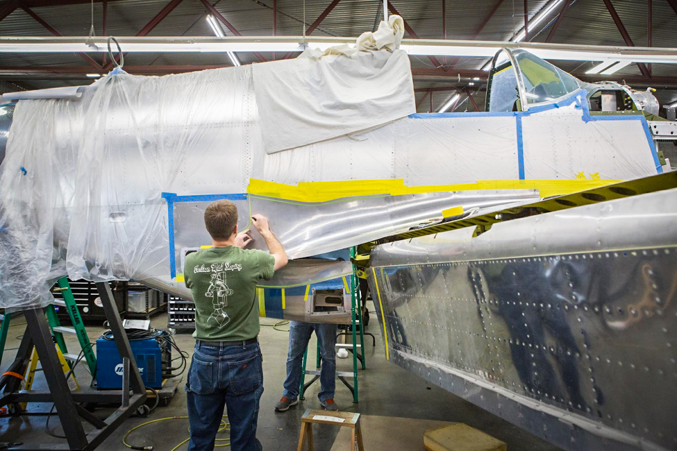 Randy tapes the final outer contour before trimming the fillet. (photo via AirCorps Aviation)