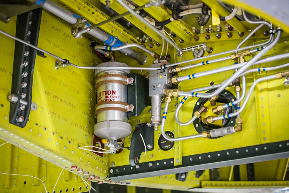 The hydraulic accumulator stores pressurized hydraulic fluid for the retract system. (photo via AirCorps Aviation)