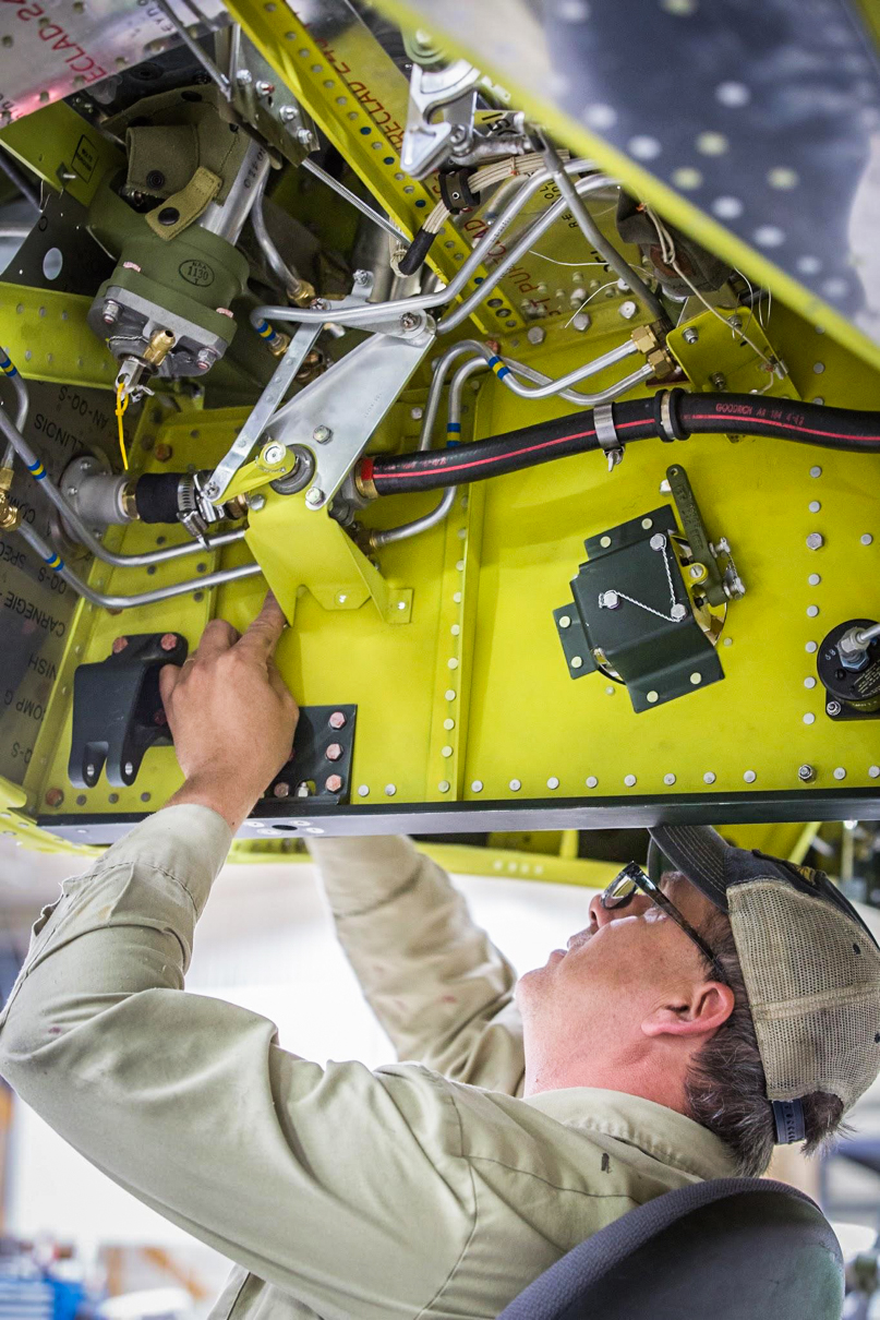 Robb is installing the bracket for the fuel shut off linkage. (photo via AirCorps Aviation)