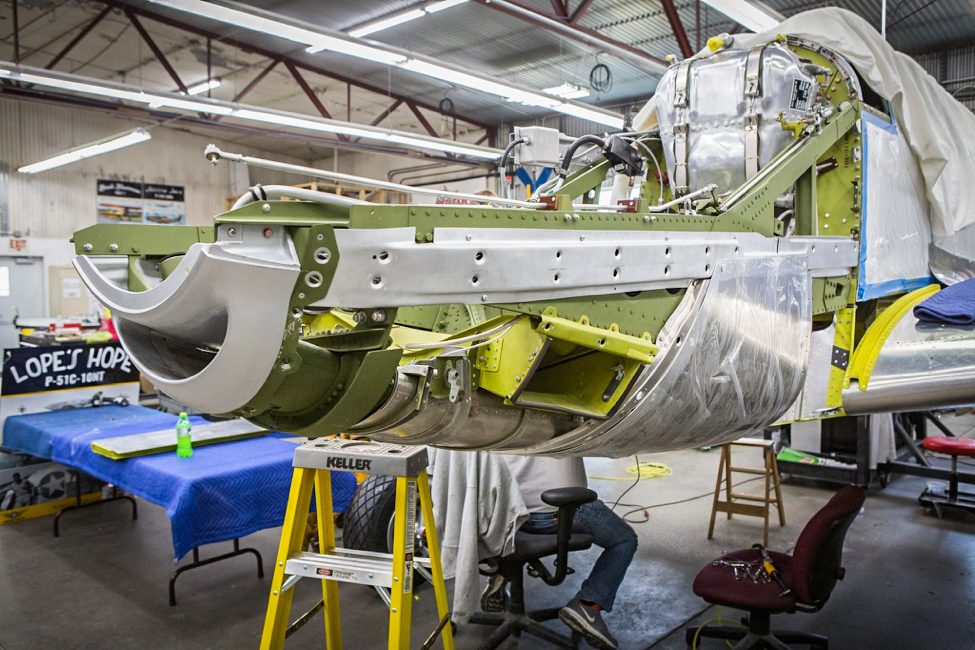 "The oil tank is on the firewall and the engine mount assemblies support the ""smile"", lower rear cowl section, and the air cleaner boxes. (photo via AirCorps Aviation)"