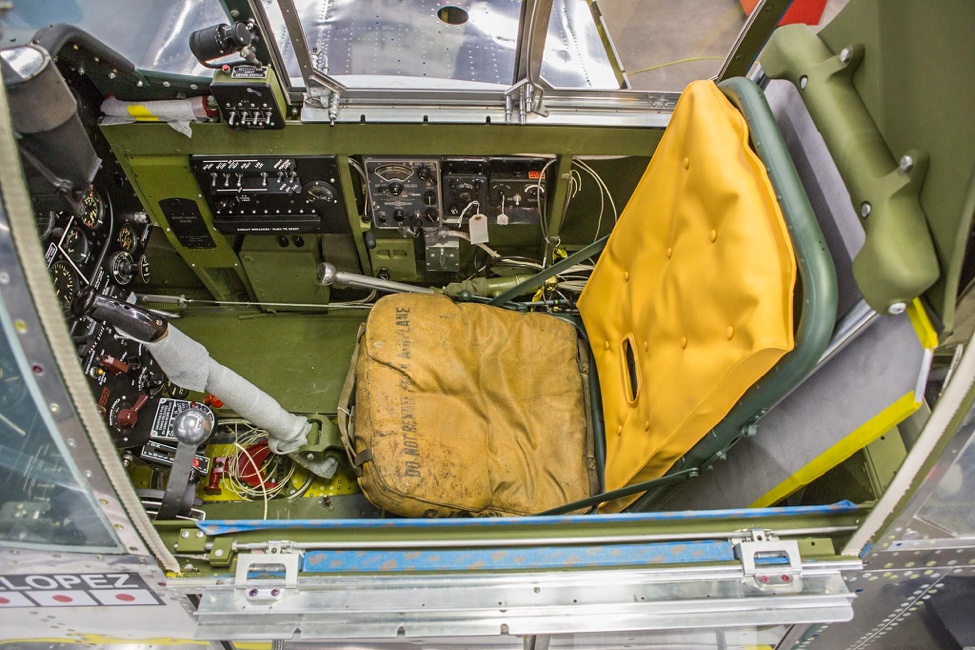 In this view of the seat and stick from above, you can see that there is still some wiring being done. (photo via AirCorps Aviation)