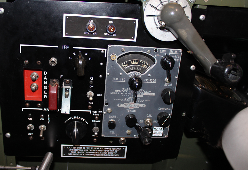 Pilot's radio package. Note the impact destruct switch (the red panel with two silver buttons). (photo via Tom Reilly)