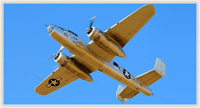 Planes of Fame's B-25J known as 'Photo Fanny' aloft over Chino, California. (photo via Planes of Fame)