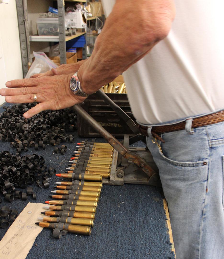Pressing the linker. (photo via Tom Reilly)