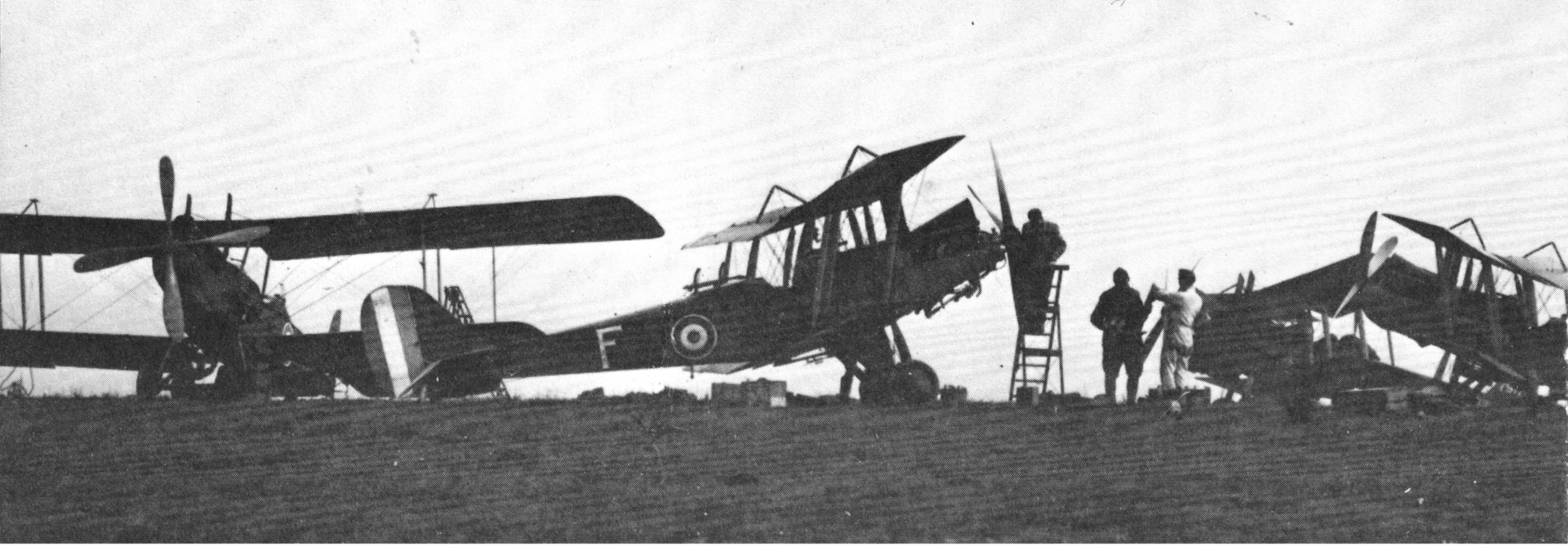 Personnel from 3 Squadron of the Australian Flying Corps and their R.E.8s during WWI. (photo via Wikipedia)