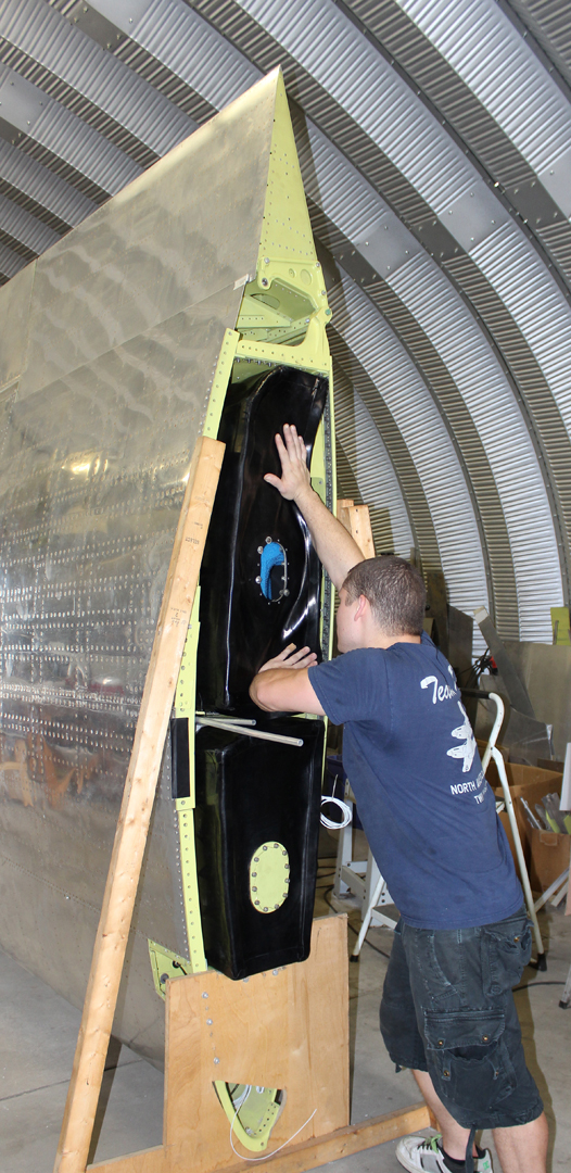 Installing the right hand wing fuel tanks (205 gallons total). (photo via Tom Reilly)