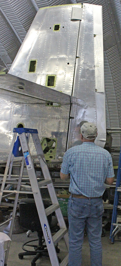 Tom Reilly inspecting the freshly-installed, right-hand rudder. (photo via Tom Reilly)