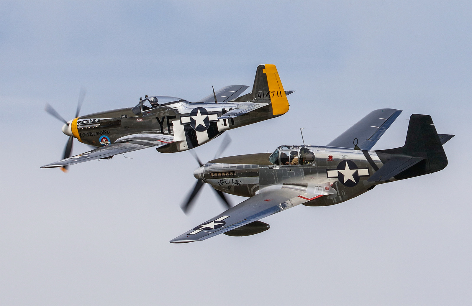 Lopes Hope 3rd in close formation with the P-51D chase plane for the test flight, TFLM's Dakota Kid. (photo by Randy Ruttger via AirCorps Aviation)