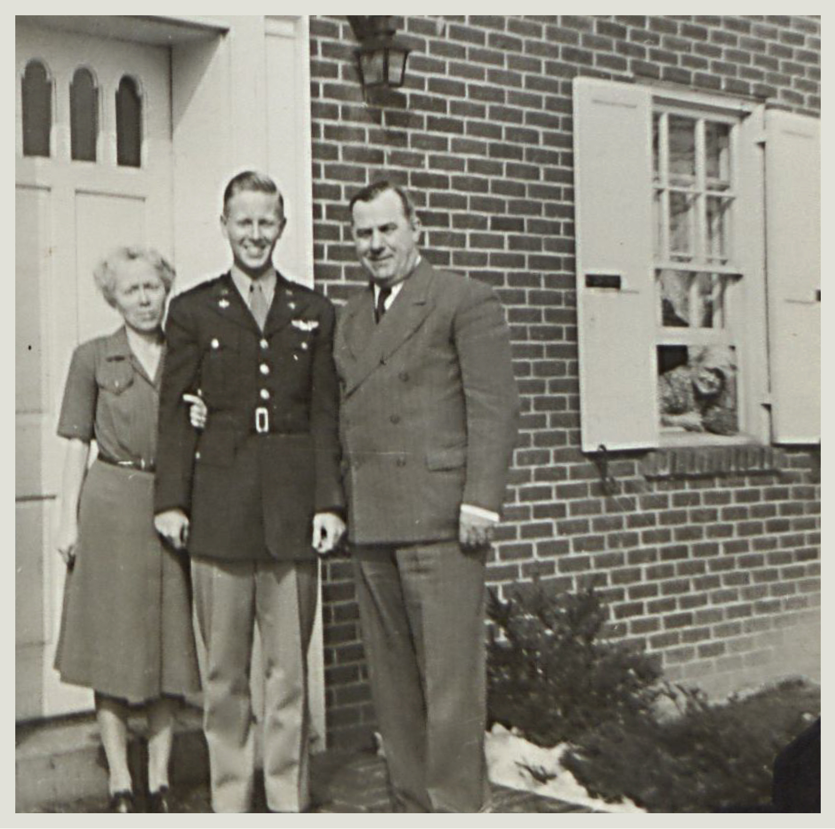Ralph L. Minker Jr with his parents (and grandmother Jones looking out of the window), Wilmington,  DE circa 1944. (photo used with permission from Delaware Historical Society Collection)