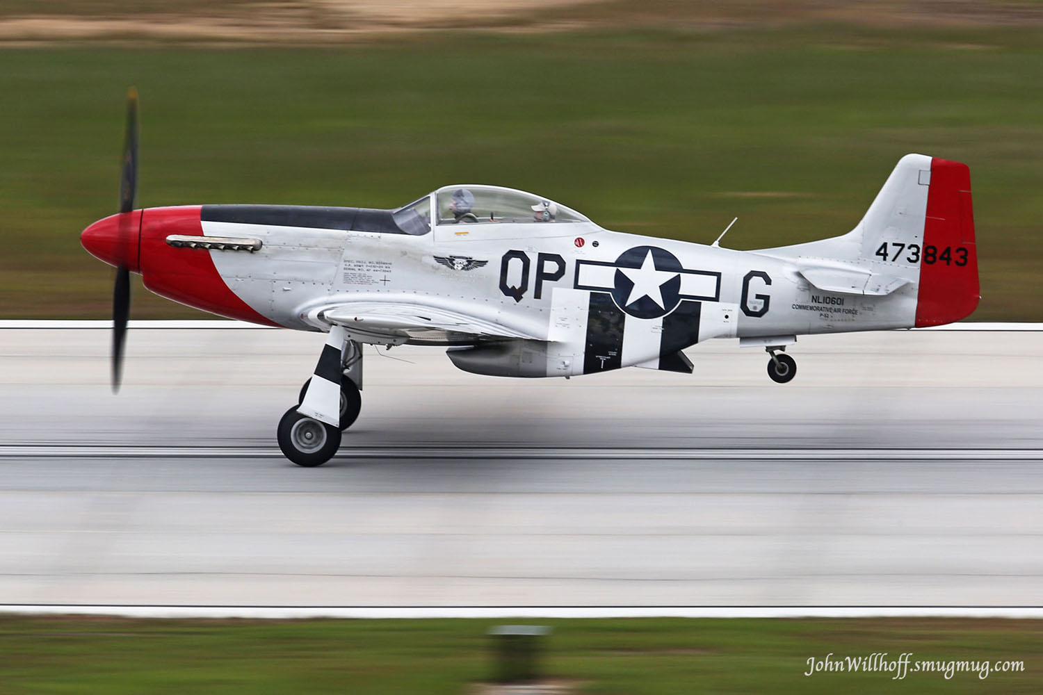 "The mighty ""Red Nose"" giving a ride to a lucky passenger during the 2014 Atlanta Warbird Weekend. ( Photo by John Willhoff)"