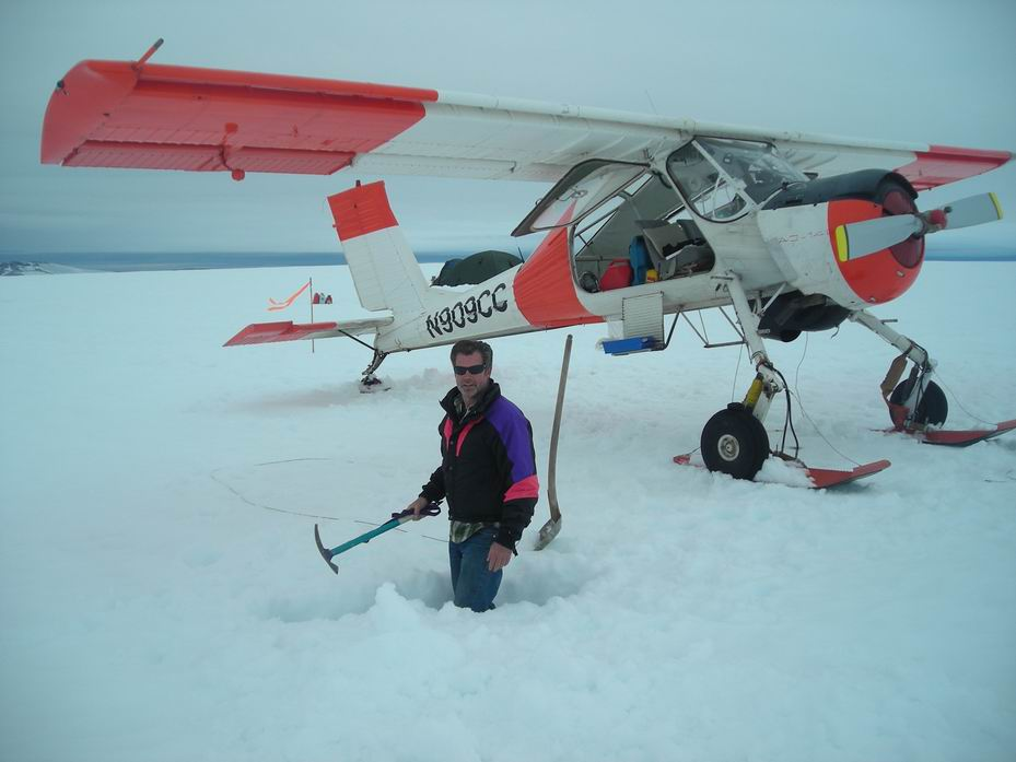 Burying the rods to tie the Wilga support plane down to the ice cap. (photo via Ken McBride)