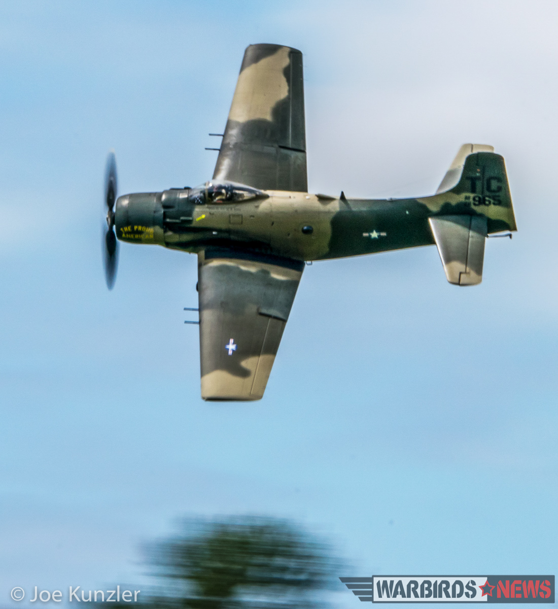 The Skyraider screaming over the tree tops. (photo by Joe Kunzler)
