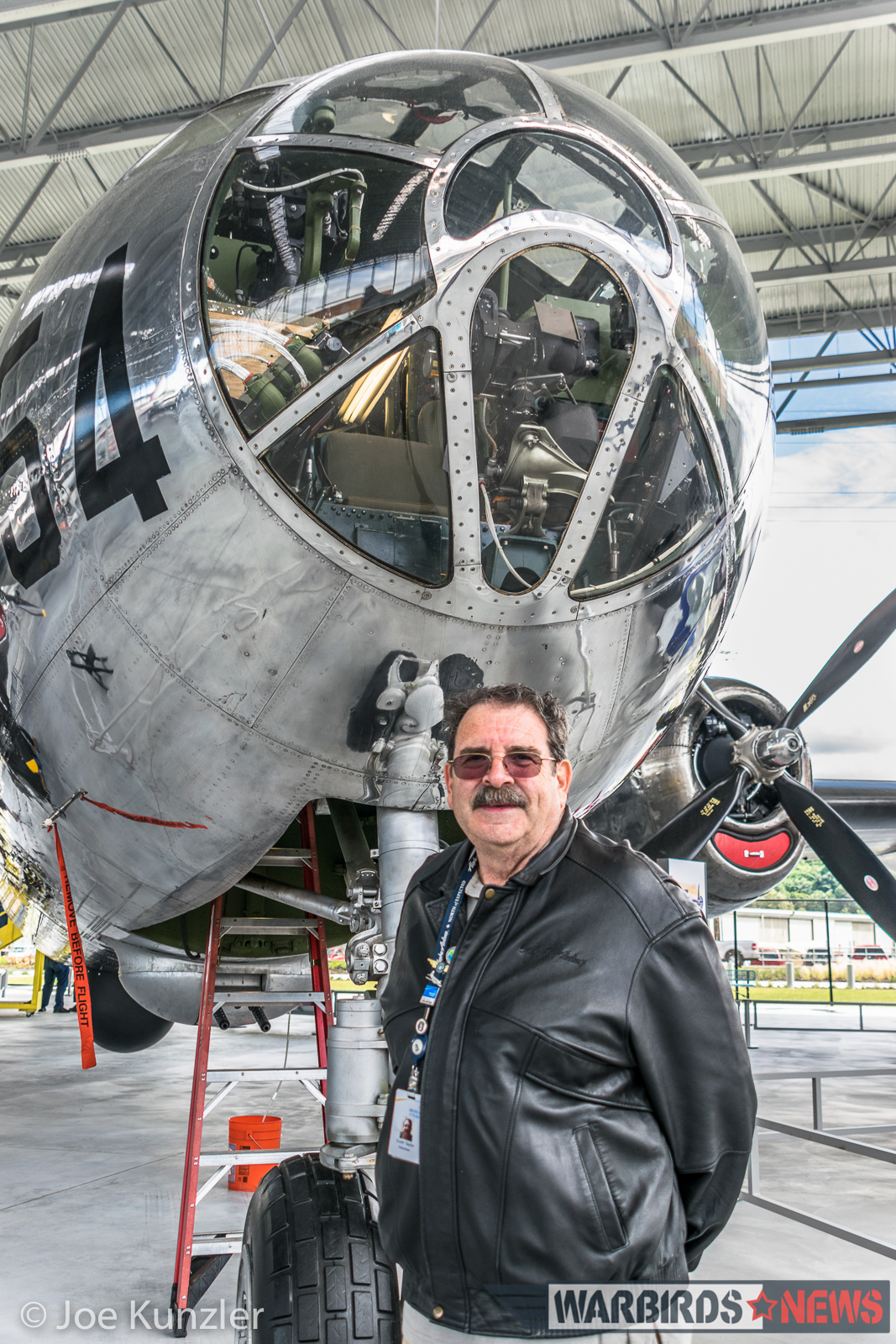 Scott Taylor and the B-29 he helped to restore. (photo by Joe Kunzler)