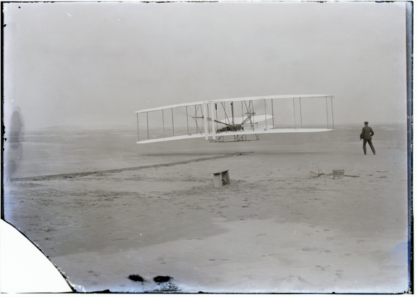 Orville takes off with Wilbur running beside, December 17, 1903. ( Original Image)