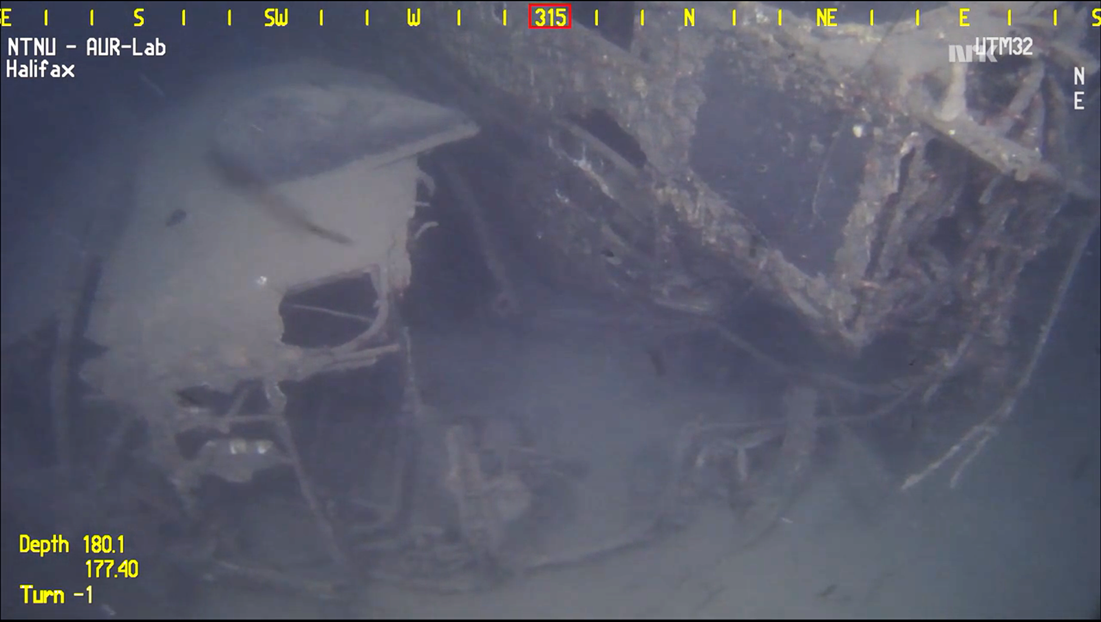 The Halifax's forward fuselage torn from the aircraft, lies on its left side beside the cockpit. (screen capture of video fromNTNU AUR-LAB)