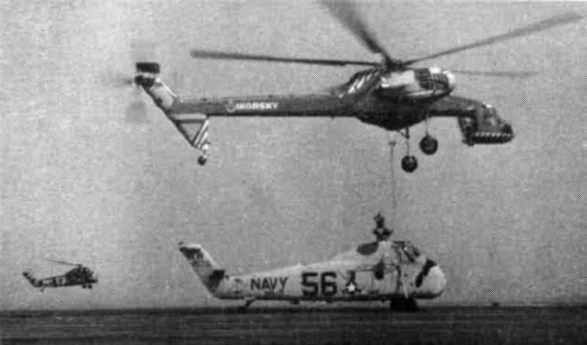 The Sikorsky S-60 during trials showing it lifting an S-58 at Quonset Point, RI. (photo via Wikipedia)
