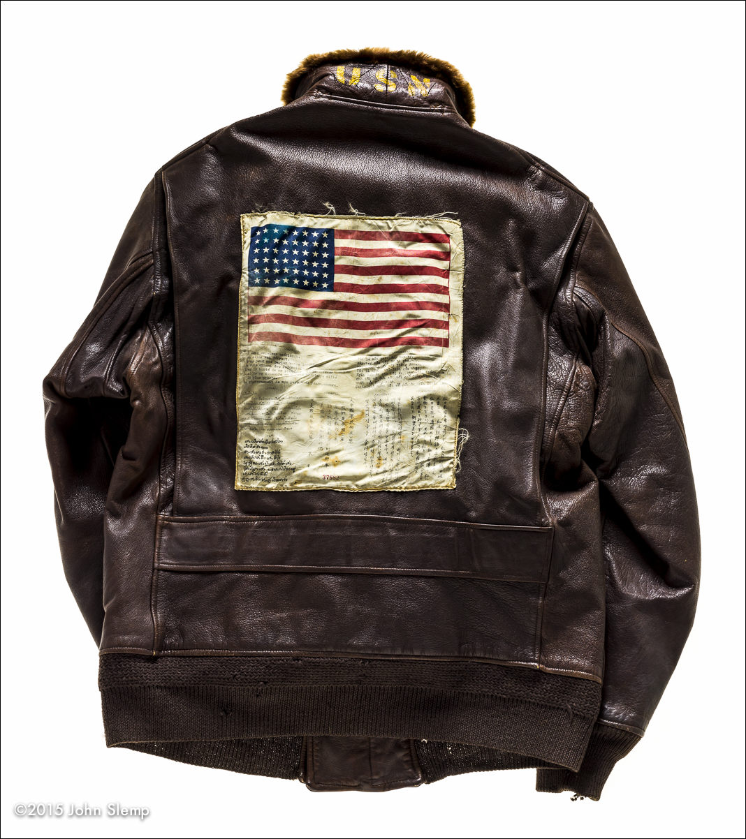 "The ""blood chit"" on the back of the jacket was a billboard, written in many of the SE Asian languages, basically advising locals that the wearer was an American serviceman. If aided with food and shelter, and safely returned to allied lines, there would be a reward for their efforts.  Notice the ""USN"" on the collar.  This G-1 belongs to the National Naval Aviation Museum collection in Pensacola, Florida."