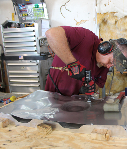 Shaping stainless steel sheet into the liners for the interior of the main gear doors. (photo via Tom Reilly)