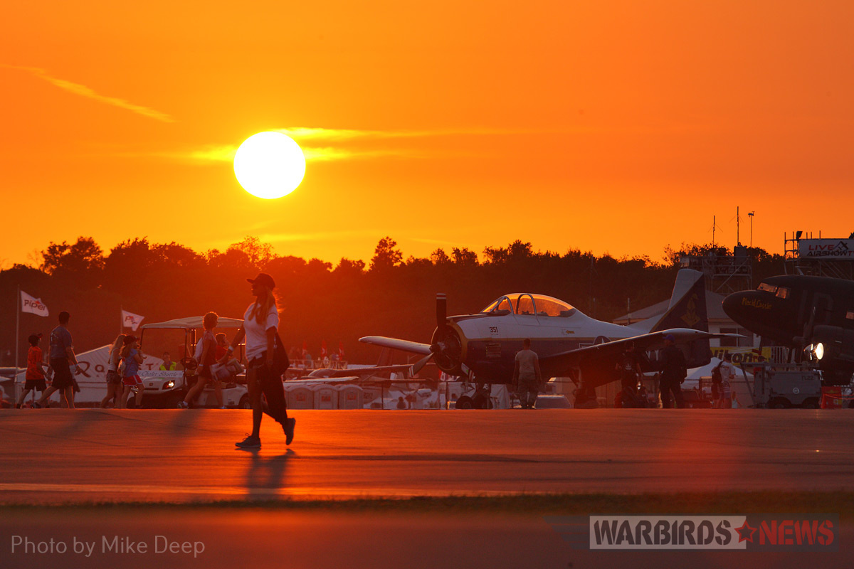 The sun sets on the Warbird Ramp Wednesday. Earlier that evening, the Mustangs gathered here were whisked away to shelter in anticipation of an approaching storm front.