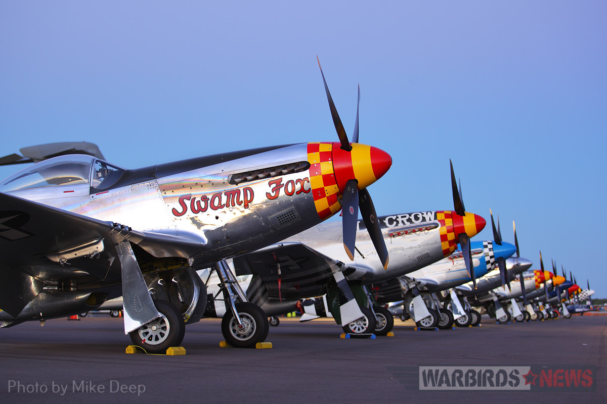 A row of Mustangs, seen here in twilight Thursday, held a commanding presence on the Warbird Ramp for most of Sun 'n Fun.