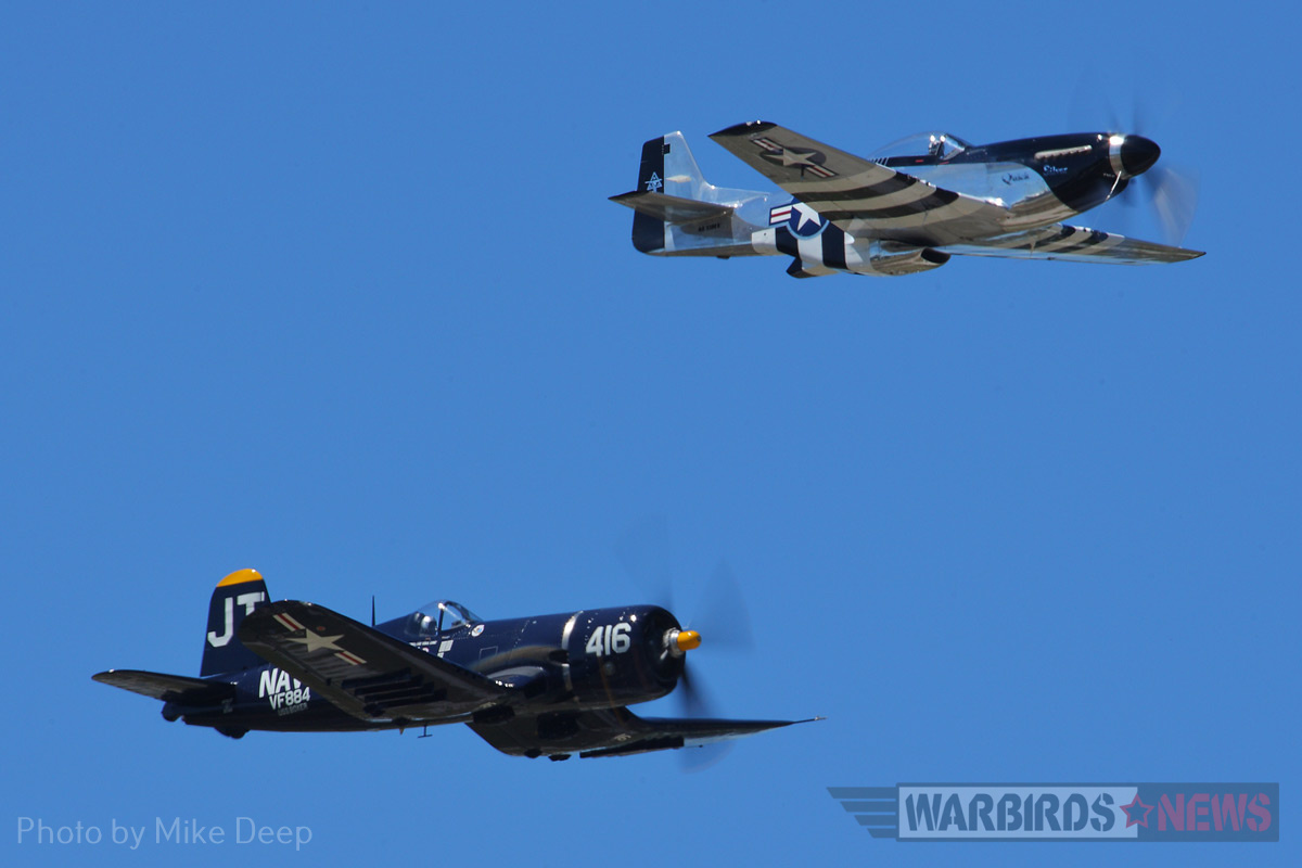 Jim Tobul's F4U Corsair 'Korean War Hero' and Scott Yoak's P-51 'Quick Silver' fly in 'The Class of '45' during Saturday's airshow.