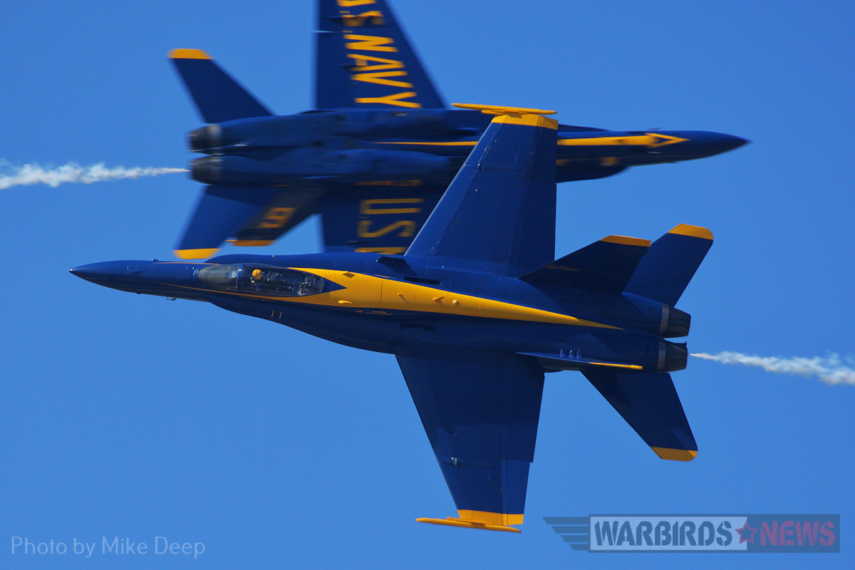 The Blue Angels perform an opposing knife-edge pass on Saturday. Though they were billed as a weekend performer, the Blue Angels flew practice demonstrations on Thursday and Friday.