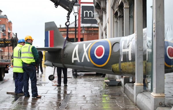 Technicians gently ease the fuselage of Spitfire FR.XIVe MT847 out of the Museum of Science and Industry in Manchester, England on February 9th. (photo by Chris Foster, via RAF Museum)