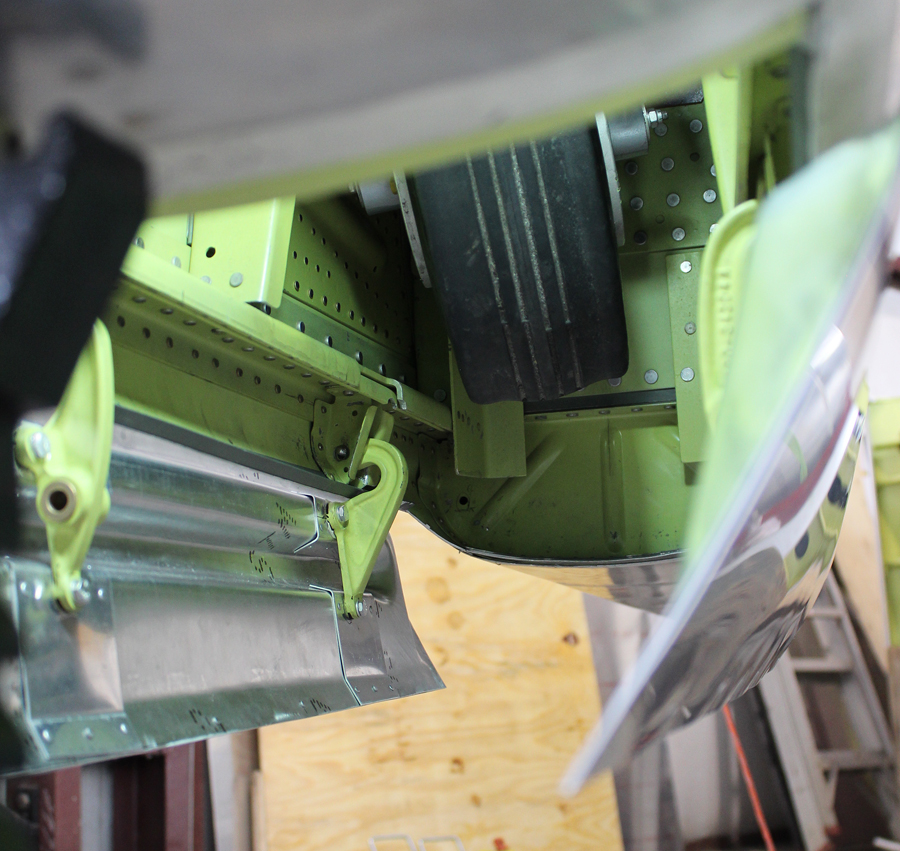 The tail wheel gear doors mounted in place during the test-fitting. (photo via Tom Reilly)