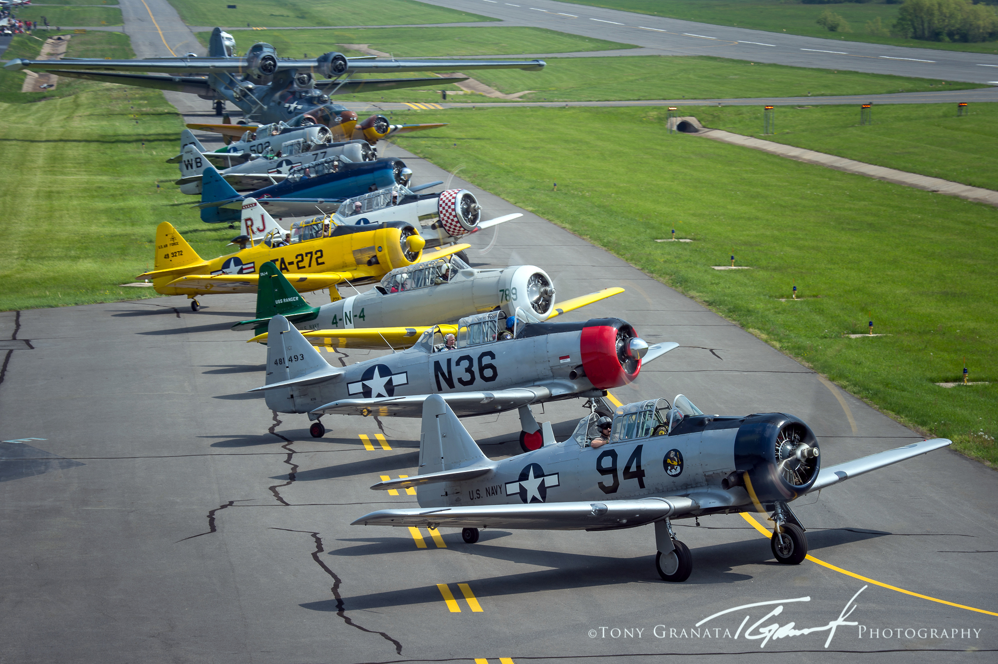 T-6 Trainers lineup for take off in Culpeper,VA in occasion of the Arsenal of Democracy flyover. ( Photo by Tony Granata)