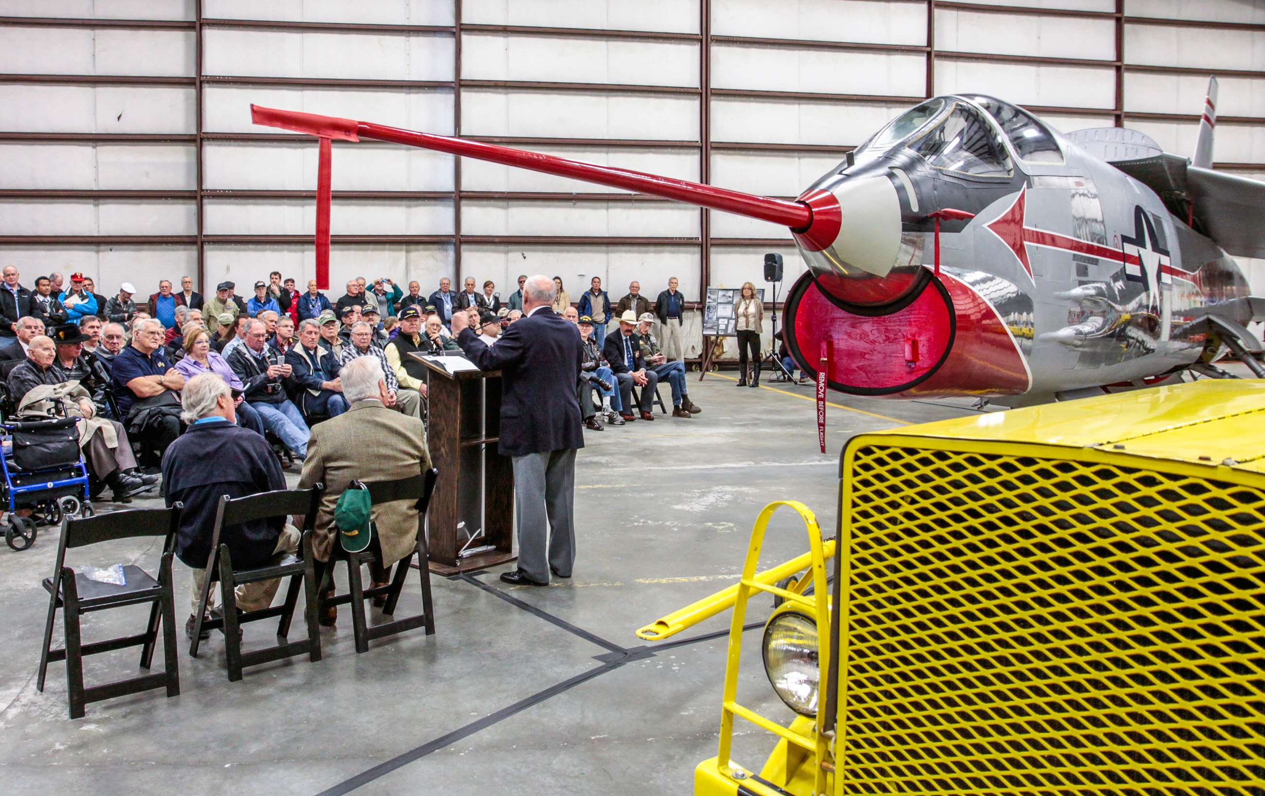 The unveiling ceremony underway for the Museum of Flight's Chance Vought XF8U-1 Crusader prototype at their restoration center in Everett, Washington. (photo by Ted Huetter/Museum of Flight)
