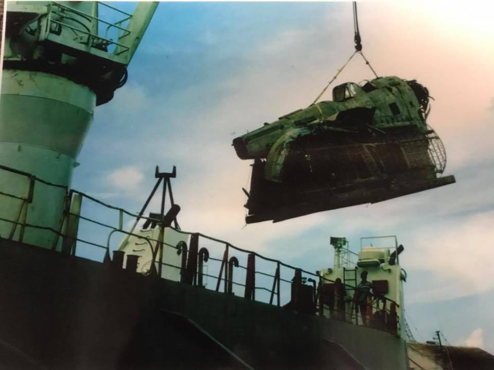 The Grumman Duck being hoisted aboard a ship bound for Miami following its recovery in the Bahamas. (photo via Mid America Flight Museum)