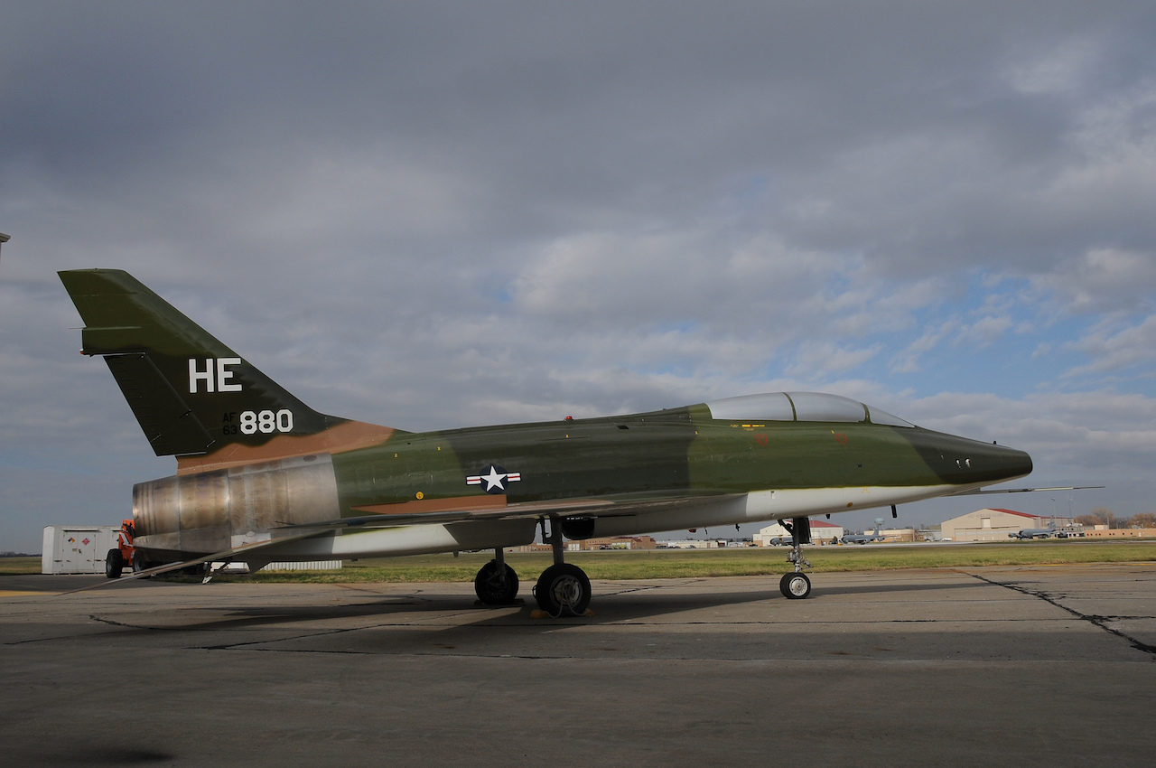 "The last North American Aviation, F-100 Super Sabre housed at the Aerospace Maintenance and Regeneration Group, or ""boneyard"", was painted and restored at the Air National Guard paint facility in Sioux City, Iowa. The F-100 was flown by the Iowa National Guard's 174th TFG in Sioux City during the 1960s and 70s and will be placed on permanent static display at the National Guard Bureau at Andrews Air Force base in Maryland. (Air National Guard Photo by: Master Sgt. Vincent De Groot 185 ARW /PA)"