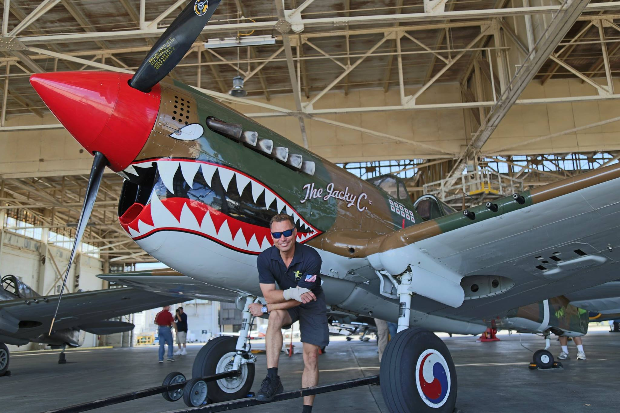 Thom Richard in front of the American Airpower Museum's P-40 in occasion of the 2016 Atlanta Warbird Weekend. (Photo by Kenneth Strohm)