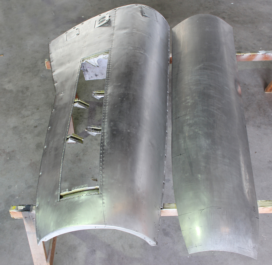 A completed cowling panel (left) beside the newly wheeled skin for its counterpart to the right. (photo via Tom Reilly)