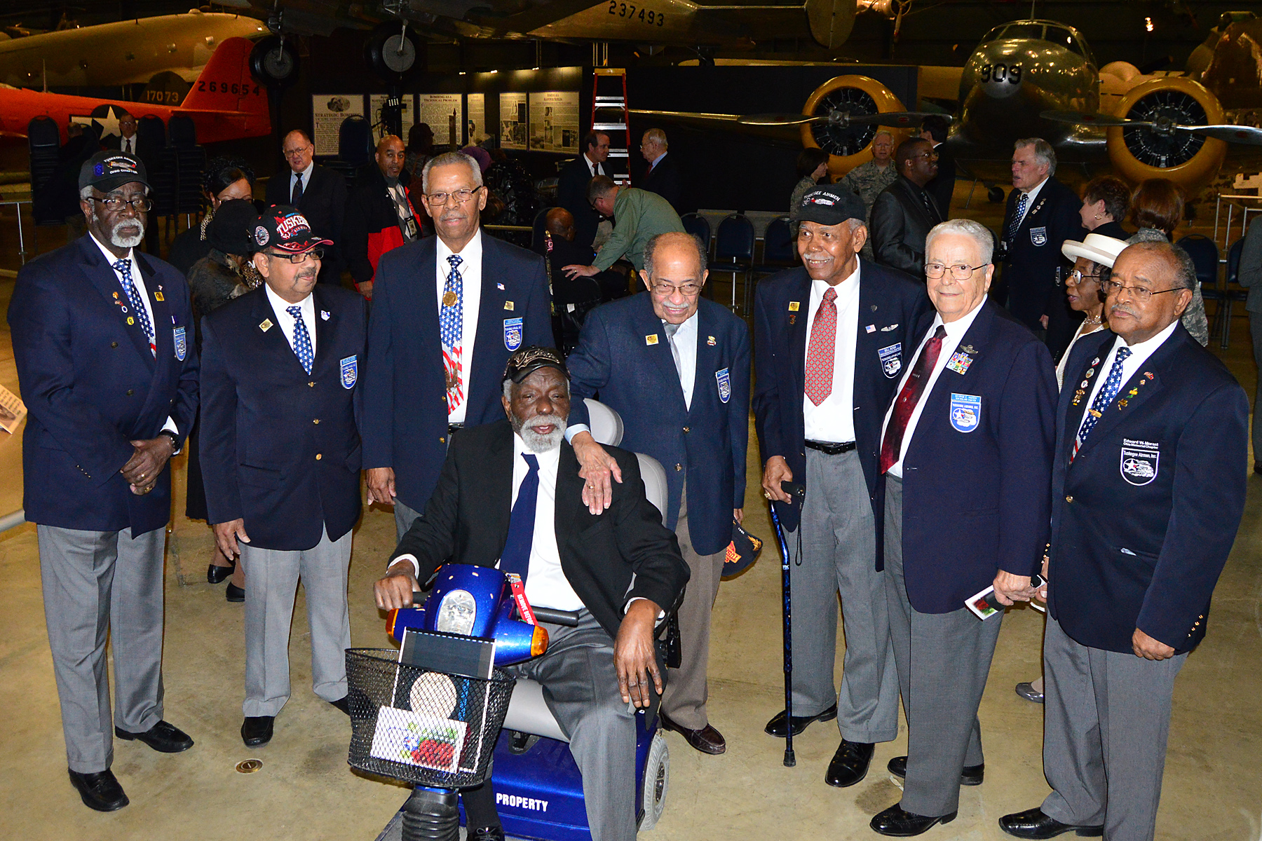 Tuskegee Airmen and Honorary Tuskegee Airmen gathered for photographs at the expanded Tuskegee Airmen exhibit opening in the WWII Gallery at the National Museum of the U.S. Air Force on Feb. 10, 2015. (U.S. Air Force photo)