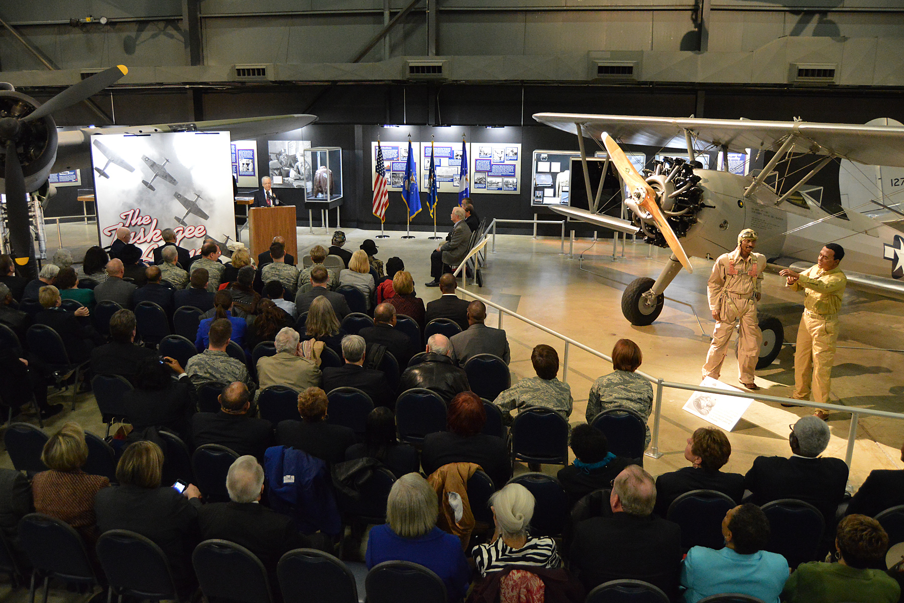 Tuskegee Airmen, families, friends and guests, gathered for the expanded Tuskegee Airmen exhibit opening in the WWII Gallery at the National Museum of the U.S. Air Force on Feb. 10, 2015. (U.S. Air Force photo)