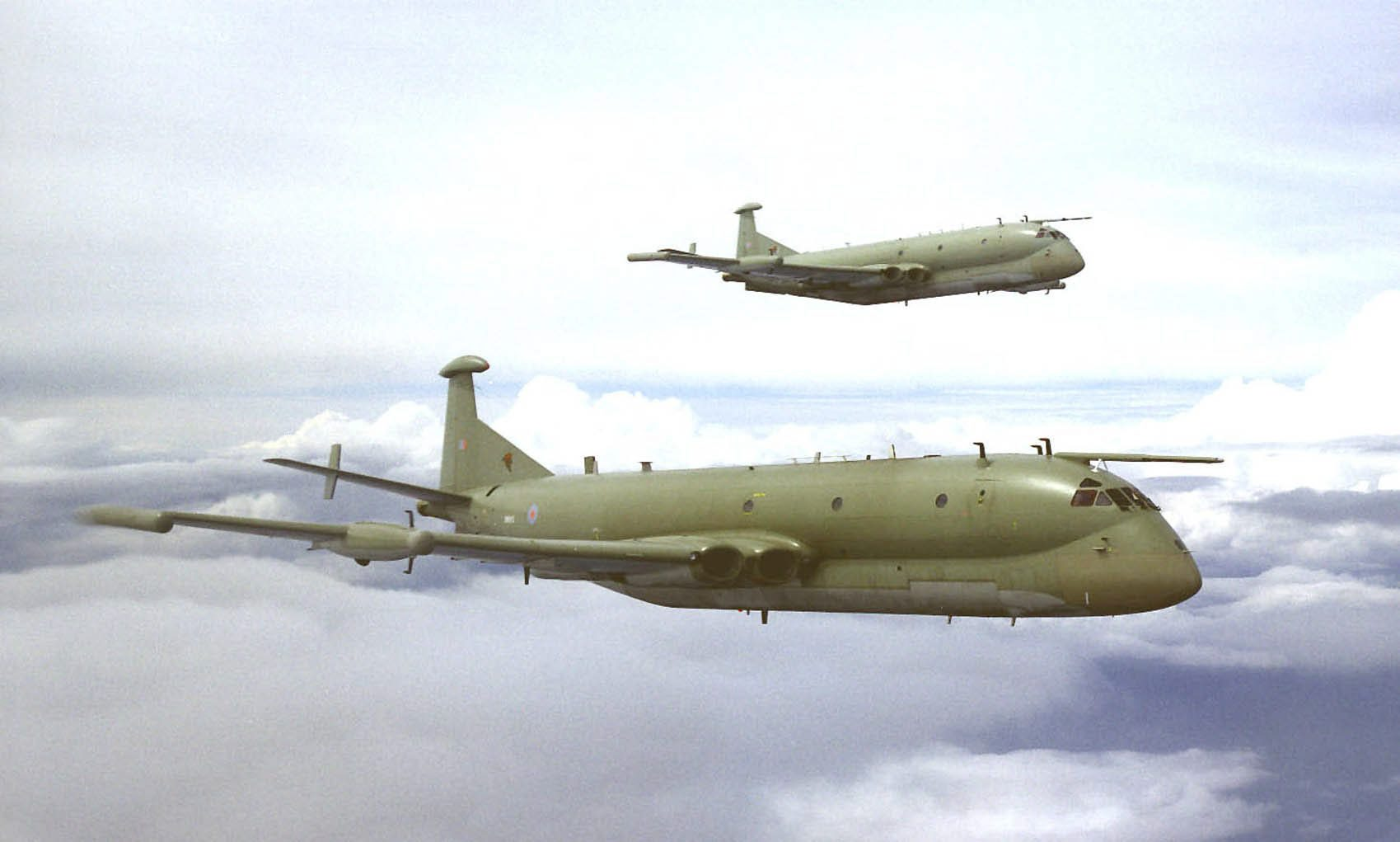 "Two Nimrod R1s of 51 Squadron, based at RAF Waddington, pictured flying in formation when still wearing their ""hemp"" camouflage. XV249 is quite possibly pictured here. (photo via Wikipedia)"